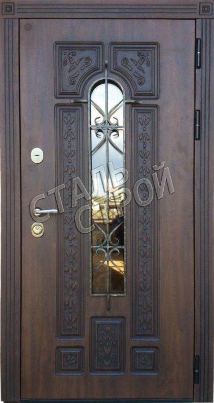 входные двери в коттедж со стеклом и ковкой